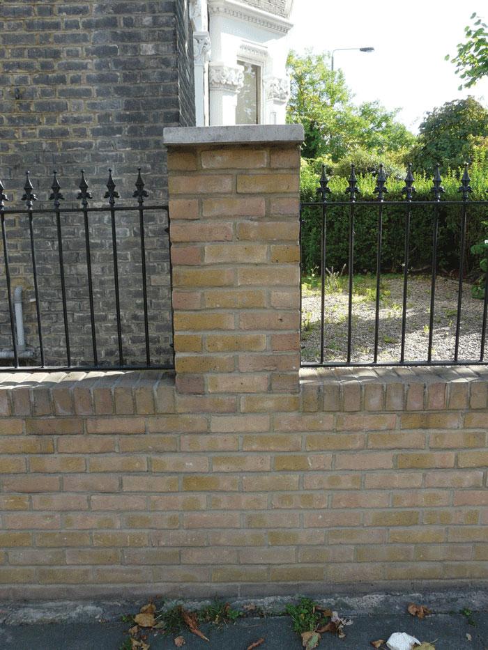 Image of Brick wall with railings