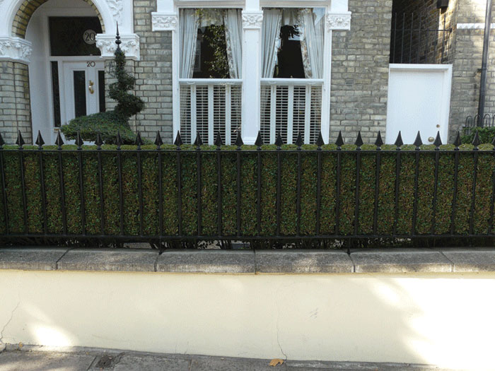 Image of Spear finial railing with topiary